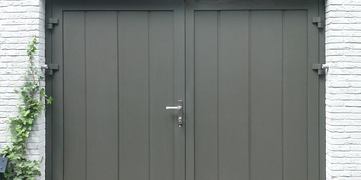 https://garagedeuren.s3.amazonaws.com/20180907153235/Openslaande-garagedeuren-Breda-2.jpg