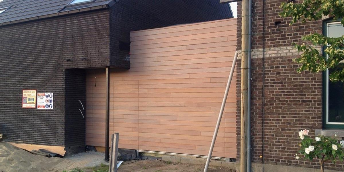 https://garagedeuren.s3.amazonaws.com/20180924113223/houten-sectionaal-deur-meranti.jpg