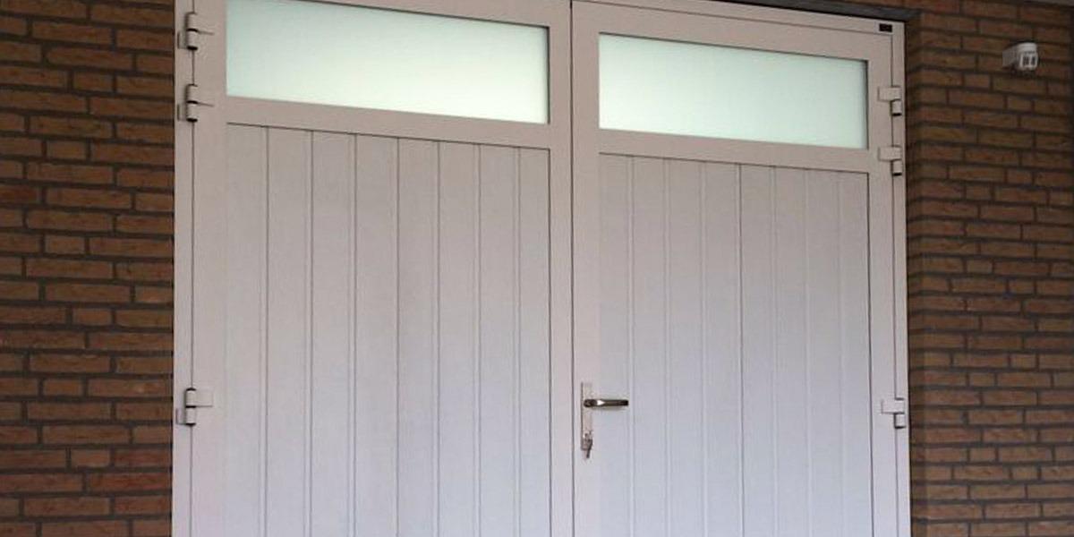 https://garagedeuren.s3.amazonaws.com/20181004121706/twee-openslaande-deuren-Geleen1.jpg