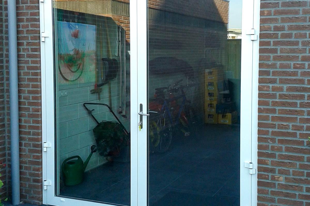 Openslaande garagedeuren volledig glas