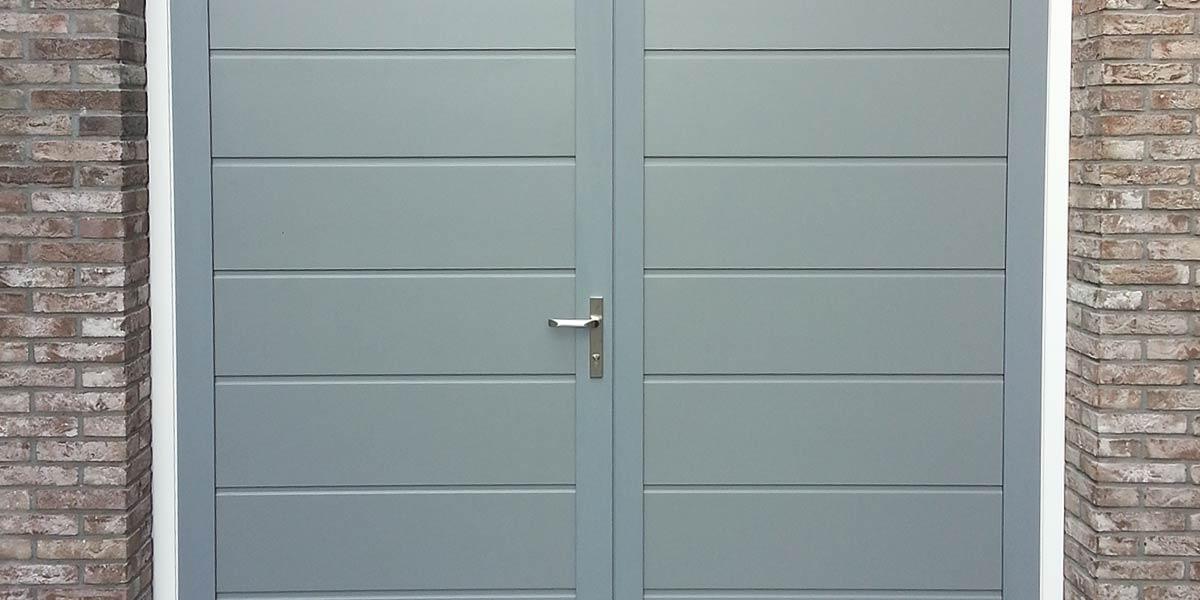 https://garagedeuren.s3.amazonaws.com/20181011143539/Garagedeur-openslaand-braambrugge-onderhoudsvrij-2.jpg