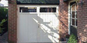 openslaande garagedeuren wit