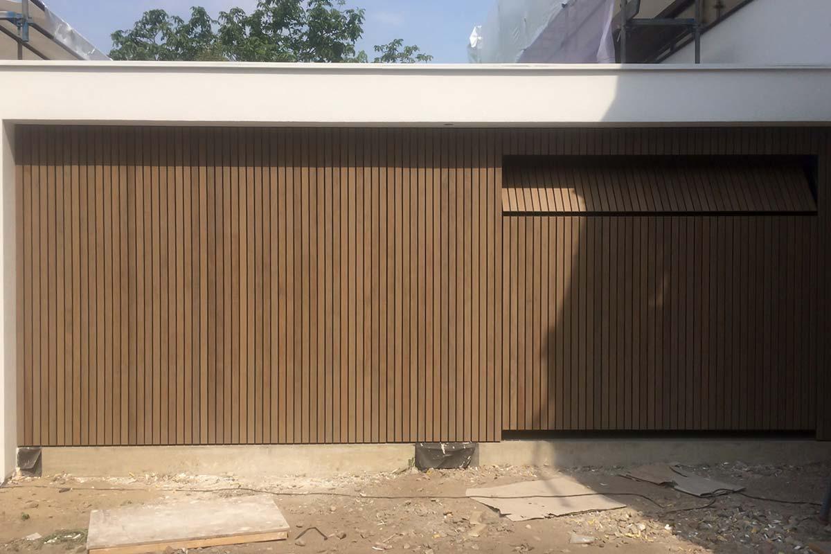 houten-sectionaaldeuren-gelijk-met-de-gevel