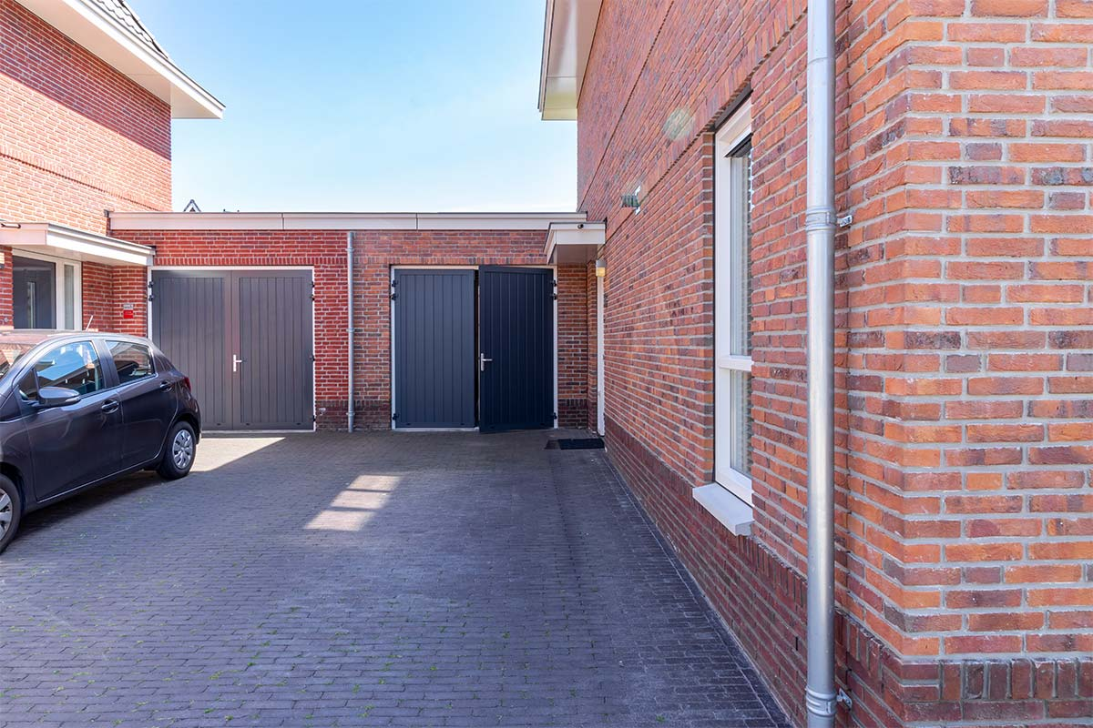 openslaande garagedeuren kunststof