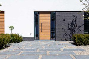 houten voordeur in aluminium kozijn