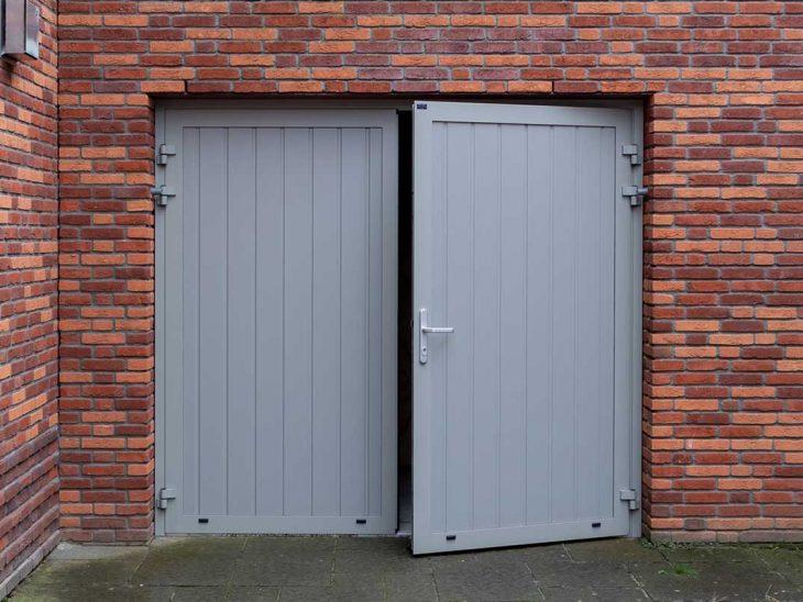 openslaande garagedeur verticaal onderhoudsarm
