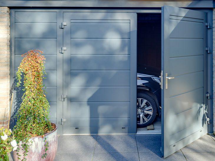 openslaande garagedeur vast zijstuk