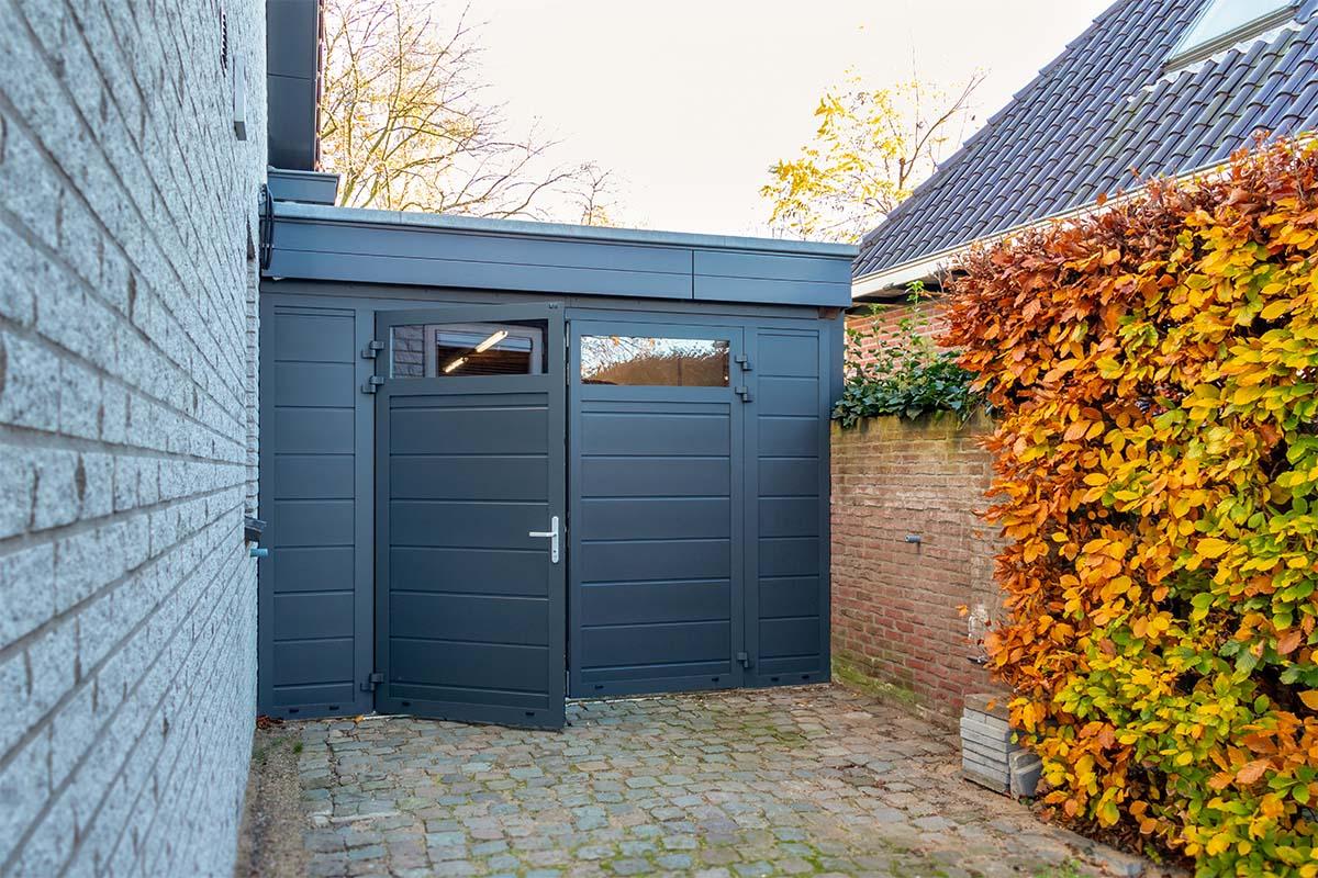 openslaande garagedeur met glas